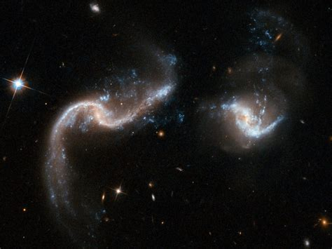 Two galaxies are slowly merging together - Nerd Reactor