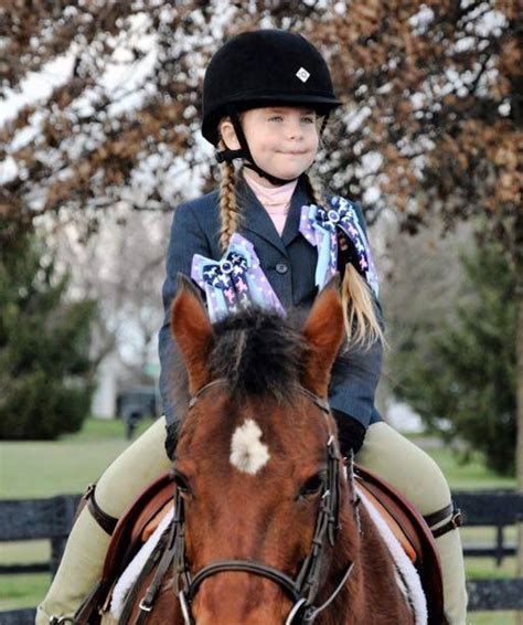 Cute girl in pony bows at horse show leadline class