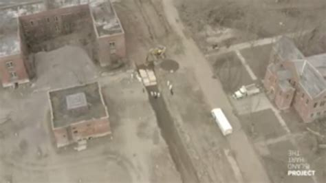 Drone video shows inmates digging mass burial graves on
